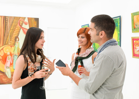 art gallery: close-up of young caucasian woman giving an interview in an art gallery