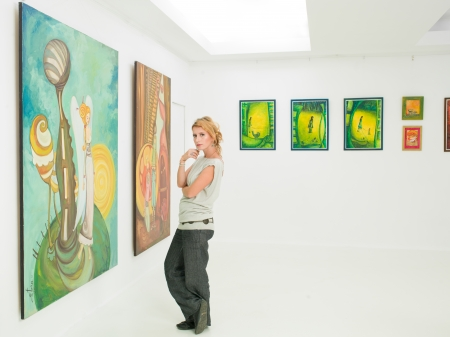 art gallery: young caucasian woman standing and posing in an art gallery Stock Photo