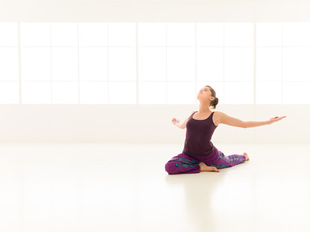 young girl , demonstrating yoga pose, full front view. Stock Photo