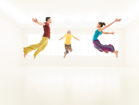 levitate: colorful young people are freestyling in stydio white background glass