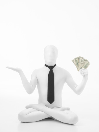 Unknown person standing in position dressed in white suit with black tie holding dollar bills photo