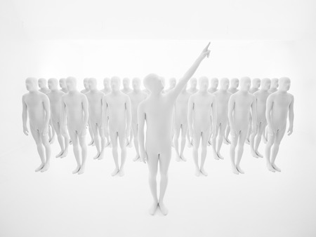 buisinessman: leading man dressed in white, with crowd of people