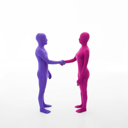 unrecognizable man dressed in purple shakes hands with faceless woman dressed in pink