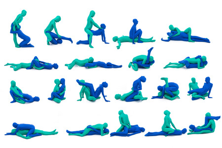 onherkenbare man gekleed in groene seks met onherkenbare vrouw in blauw pak Stockfoto