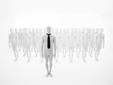 buisinessman: leading man dressed in white wearing a black tie, with other white mannequins