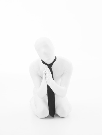 Unknown person dressed in white suit with black tie photo