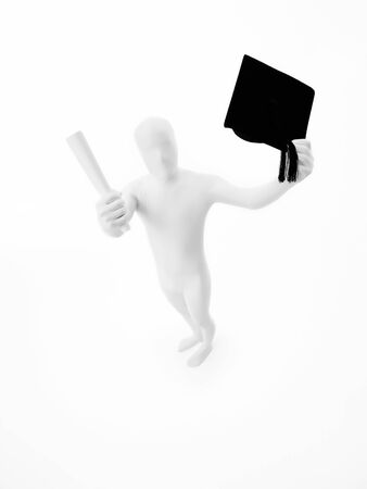 Unknown person dressed in black tie and white suit holding graduation hat and diploma, top view photo