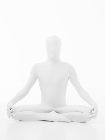 swadhisthana: faceless man dressed in white sitting in yoga lotus position, front view