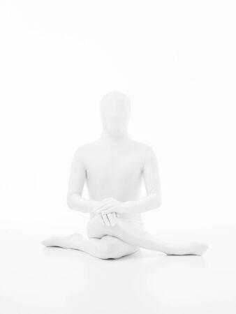 karmic: faceless man dressed in white yoga gomukhasana posture Stock Photo