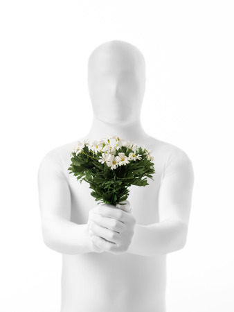 declaring: faceless man dressed  white with a bouquet of flowers in hand