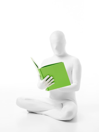 faceless man dressed  white with a book in hand sitting on the floor lotus posture photo