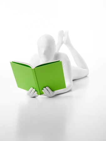 faceless man dressed  white with a book in hand sitting on the floor belly photo