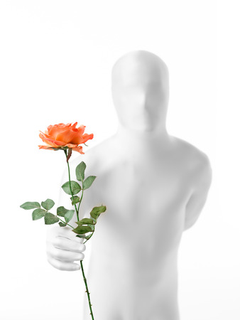 faceless man dressed  white with a rose in hand photo