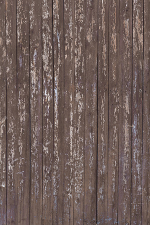 old wooden fence with brown paint flaking photo