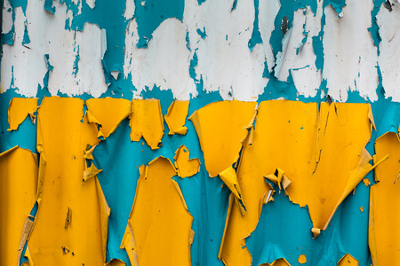 flaking: The blue and yellow paint flaking vibrant colors