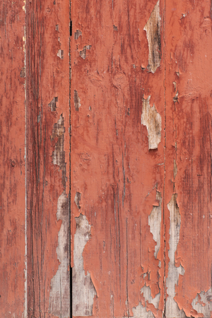 old wooden fence with paint flaking brown photo