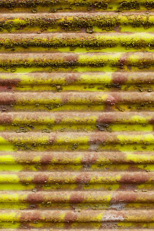 goffer: metal fence and yellow paint flaking layers