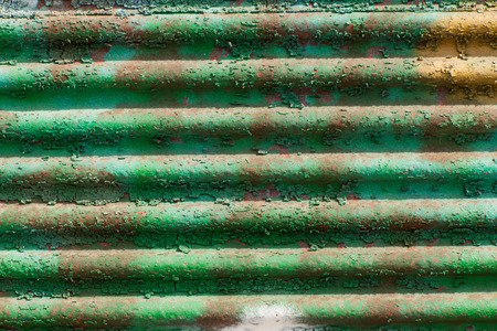 goffer:  metal fence and green paint flaking layers
