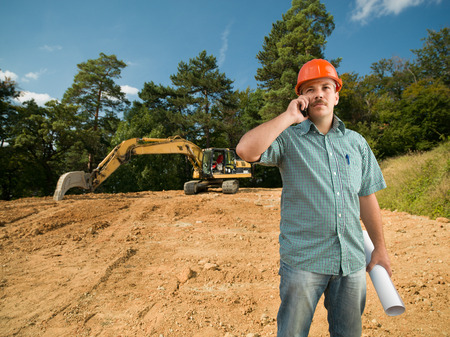 engineer talking on the phone on construction site photo