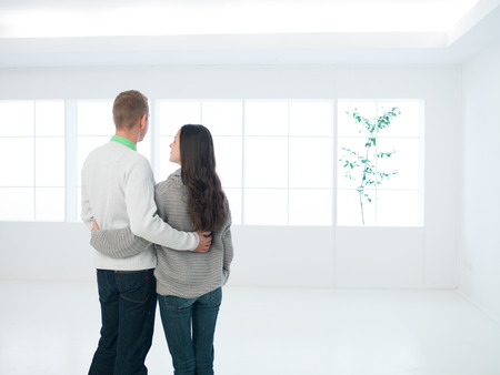 domestic scene: young couple viewing new apartment or house Stock Photo
