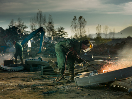 workers welding metal outdors 스톡 콘텐츠