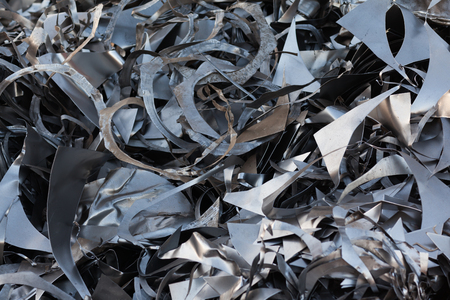 scrap iron: pile of metallic chips in landfill for recycling. abstract pattern