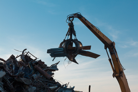 grabber: closeup of crane claw loadd with scrap metal