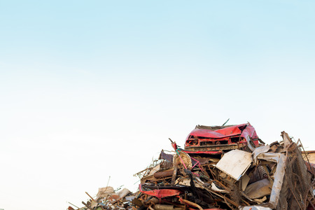 recycling center: scrap metal parts at recycling center junkyard, with clear sky. copy space available Stock Photo