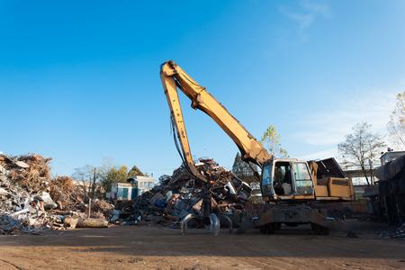 grabber: side view of crane on recycling junkyard