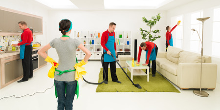 chores: man cleans house in different places at the same time while woman supervise progress