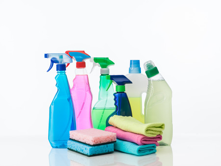 cleaning supplies on white background photo