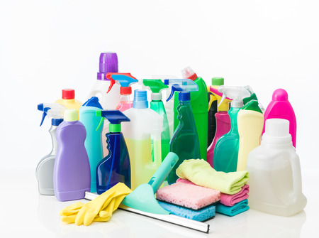 group of cleaning products and equipment on white background photo