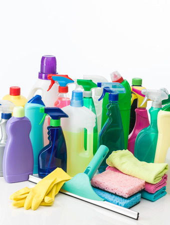 spotless: closeup of cleaning supplies on table with white background. copy space available
