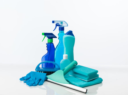 still life with cleaning supplies with different shades of blue, on white background Archivio Fotografico
