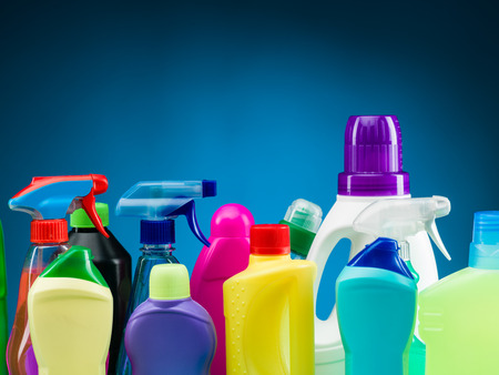 close-up of cleaning supplies and products against blue background 스톡 콘텐츠