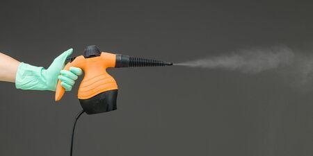 hand holding pressure steam cleaner