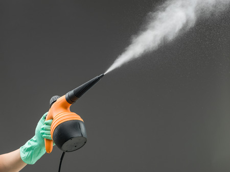 one person working with steam cleaner