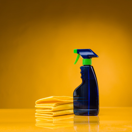spray bottle with liquid detergent and microfiber cloth Stock Photo