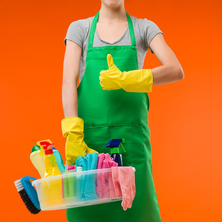 cleaning lady holding supplies and showing thumb up