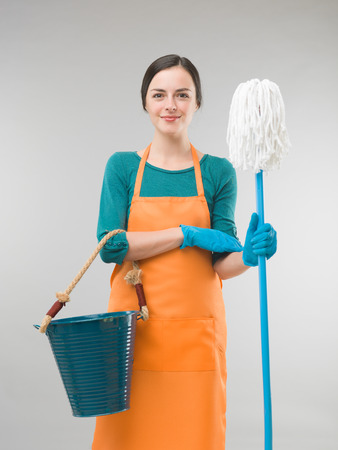 mops: cleaning woman with mop and bucket against grey background