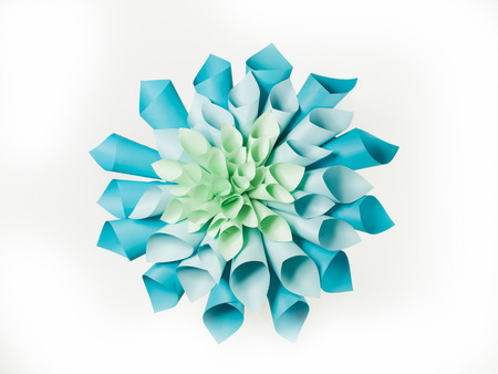 origami: abstract image of origami flower shape made out of rolled sheets of paper on white background Stock Photo