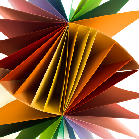 macro image of colored sheets of paper arranged in helix fan shape Stock Photo