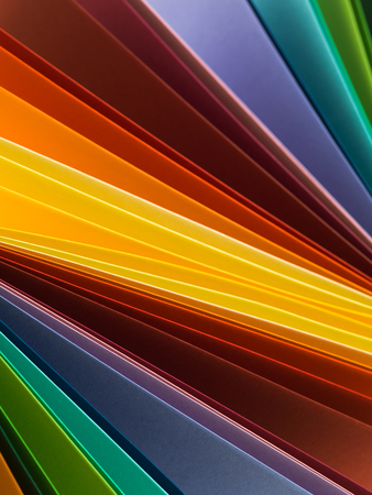 uneven edge: macro image of multi colored paper. abstract background Stock Photo