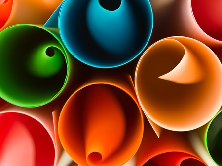 curledup: macro image of colorful rolled up paper. abstract pattern