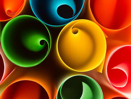 color image creativity: macro image, top view of group of rolled up colorful sheets of paper