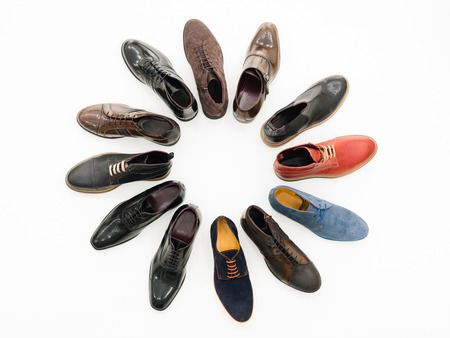 upper view, variety of male shoes arranged in circle, isolated on white background Stock Photo