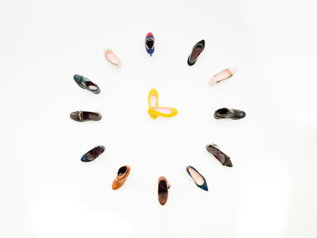 chamois leather: top view of women shoes arranged in clock shape, isolated on white background Stock Photo