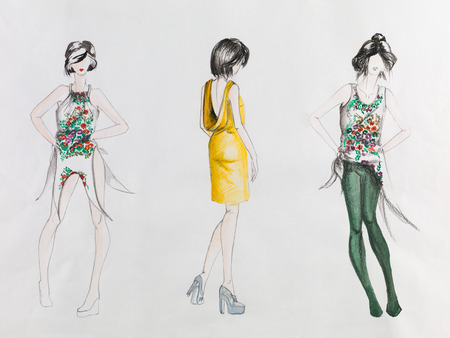 fashion illustration: hand drawn fashion sketch with models  wearing colored modern clothing with patterns, on white paper
