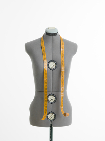 professional dressmakers dummy with measuring tape, on white background