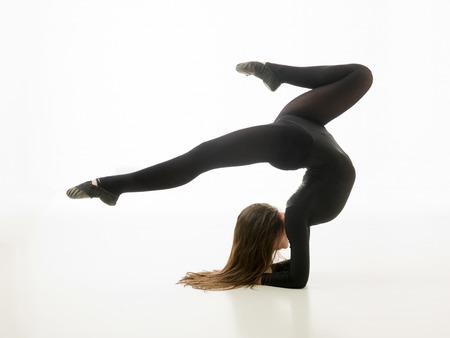 dancer practicing gymnastic yoga on white background